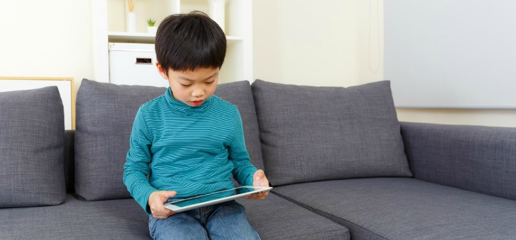 Little boy using tablet computer