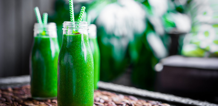 Fresh green smoothies outdoors