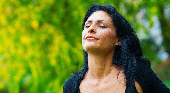 woman breathing and relaxing in nature