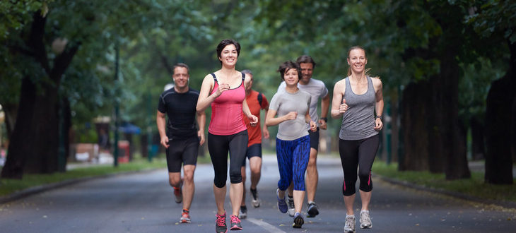 Group jogging in park