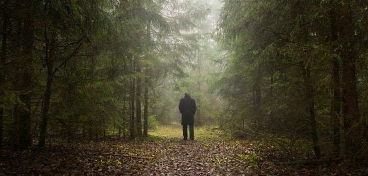 Man walking alone through forest