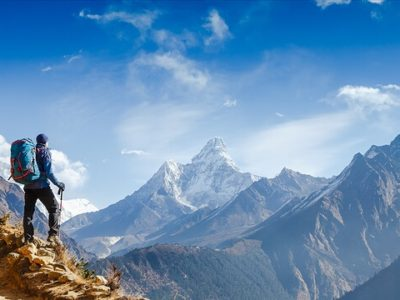 Hiker hiking mountains in Himalayas, Nepal