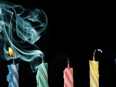 Six birthday candles that have just been blown out