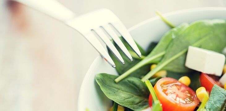 close-up-of-vegetable-salad-bowl-and-fork-at-home